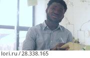 Купить «businessman with clipboard at office glass wall», видеоролик № 28338165, снято 19 апреля 2018 г. (c) Syda Productions / Фотобанк Лори
