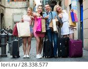 Купить «friends after shopping outdoors», фото № 28338577, снято 19 октября 2018 г. (c) Яков Филимонов / Фотобанк Лори