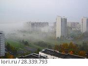 Купить «Autumn city landscape with fog in Moscow, Russia», фото № 28339793, снято 3 октября 2016 г. (c) Володина Ольга / Фотобанк Лори