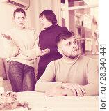 Купить «Upset man during quarrel with family», фото № 28340441, снято 27 ноября 2017 г. (c) Яков Филимонов / Фотобанк Лори