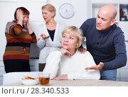 Купить «Mature man is warm apologizing to woman after quarrel», фото № 28340533, снято 16 декабря 2017 г. (c) Яков Филимонов / Фотобанк Лори
