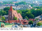 Купить «The Catholic brick church from above and the roofs of houses in Krakow on a sunny day», фото № 28343313, снято 11 августа 2017 г. (c) Константин Лабунский / Фотобанк Лори