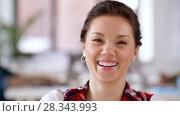 Купить «portrait of happy smiling asian woman at office», видеоролик № 28343993, снято 12 апреля 2018 г. (c) Syda Productions / Фотобанк Лори