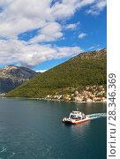 Купить «Montenegro. Beautiful view on Boka Kotor Bay and regular passenger ferry from Lepetane to Kamenari at sunny afternoon», фото № 28346369, снято 8 октября 2016 г. (c) Виктория Катьянова / Фотобанк Лори