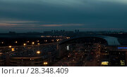 Купить «Timelapse of night city with busy roads near Sheremetyevo Airport, Moscow», видеоролик № 28348409, снято 22 сентября 2017 г. (c) Данил Руденко / Фотобанк Лори