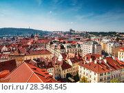 Купить «View of the red roofs of Prague and St. Vitus Cathedral on the horizon. Czech Republic», фото № 28348545, снято 5 сентября 2014 г. (c) Наталья Волкова / Фотобанк Лори