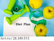Купить «Apples, diet plan,dumbbells and measuring tape», фото № 28349513, снято 11 апреля 2018 г. (c) Елена Блохина / Фотобанк Лори