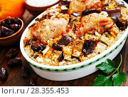 Купить «Chicken thigh baked with rice, eggplant and figs», фото № 28355453, снято 8 марта 2018 г. (c) Надежда Мишкова / Фотобанк Лори