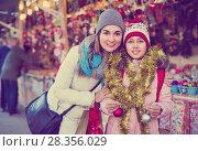 Купить «Female customers staring at counter of Christmas market», фото № 28356029, снято 21 сентября 2018 г. (c) Яков Филимонов / Фотобанк Лори