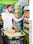 Купить «Customer telephoning to consult», фото № 28356233, снято 23 ноября 2016 г. (c) Яков Филимонов / Фотобанк Лори