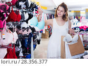 Woman buying brassiere. Стоковое фото, фотограф Яков Филимонов / Фотобанк Лори