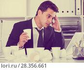 Купить «Businessman working in hot office», фото № 28356661, снято 20 апреля 2017 г. (c) Яков Филимонов / Фотобанк Лори