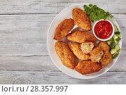 Купить «deep fried juicy breaded meat croquettes», фото № 28357997, снято 21 апреля 2018 г. (c) Oksana Zh / Фотобанк Лори