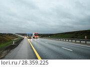 Купить «Грузовики едут по шоссе при вечернем свете», эксклюзивное фото № 28359225, снято 19 апреля 2018 г. (c) Игорь Низов / Фотобанк Лори