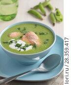 Купить «Cream of green pea soup with salmon», фото № 28359417, снято 28 мая 2012 г. (c) Stockphoto / Фотобанк Лори