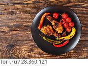 Купить «grilled chicken drumsticks on a plate», фото № 28360121, снято 22 апреля 2018 г. (c) Oksana Zh / Фотобанк Лори