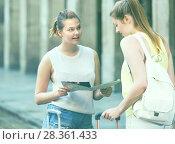 Купить «Two positive girls walking with paper map», фото № 28361433, снято 29 мая 2017 г. (c) Яков Филимонов / Фотобанк Лори