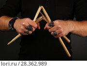 Man hands with broken drumsticks over black. Стоковое фото, фотограф Anton Eine / Фотобанк Лори