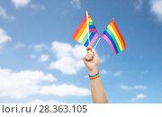 Купить «hand with gay pride rainbow flags and wristband», фото № 28363105, снято 2 ноября 2017 г. (c) Syda Productions / Фотобанк Лори