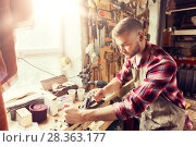 Купить «carpenter working with plane and wood at workshop», фото № 28363177, снято 14 мая 2016 г. (c) Syda Productions / Фотобанк Лори