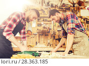 carpenters with blueprint at workshop. Стоковое фото, фотограф Syda Productions / Фотобанк Лори