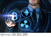 businessman with at cryptocurrency icons. Стоковое фото, фотограф Syda Productions / Фотобанк Лори