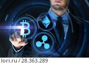 Купить «businessman with at cryptocurrency icons», фото № 28363289, снято 6 сентября 2016 г. (c) Syda Productions / Фотобанк Лори