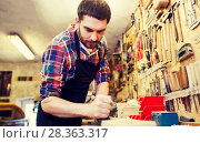Купить «carpenter working with plane and wood at workshop», фото № 28363317, снято 14 мая 2016 г. (c) Syda Productions / Фотобанк Лори