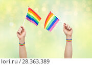 Купить «hand with gay pride rainbow flags and wristbands», фото № 28363389, снято 2 ноября 2017 г. (c) Syda Productions / Фотобанк Лори