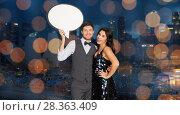 Купить «happy couple at party holding text bubble banner», фото № 28363409, снято 15 декабря 2017 г. (c) Syda Productions / Фотобанк Лори