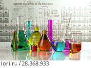 Купить «Test glass flasks and tubes with colored solutions on the periodic table of elements. Laboratory glassware. Science chemistry and research concept.», фото № 28368933, снято 22 апреля 2019 г. (c) Maksym Yemelyanov / Фотобанк Лори