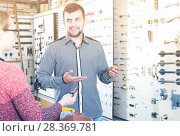 Купить «Assistant helping female customer to choose door handles», фото № 28369781, снято 5 апреля 2017 г. (c) Яков Филимонов / Фотобанк Лори
