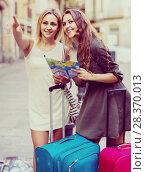 Купить «Two women with baggage checking route outdoors», фото № 28370013, снято 26 июня 2019 г. (c) Яков Филимонов / Фотобанк Лори