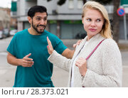 Couple is quarrelling because of the disagreements between them. Стоковое фото, фотограф Яков Филимонов / Фотобанк Лори