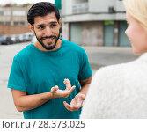 Купить «Man is acquaintancing with young woman», фото № 28373025, снято 10 августа 2017 г. (c) Яков Филимонов / Фотобанк Лори