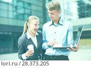 Купить «Couple professionals are examinating project on laptop», фото № 28373205, снято 15 июля 2017 г. (c) Яков Филимонов / Фотобанк Лори
