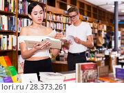 Купить «Girl reading books in library», фото № 28373261, снято 18 января 2018 г. (c) Яков Филимонов / Фотобанк Лори
