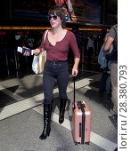 Купить «Milla Jovovich arrives at Los Angeles International (LAX) Airport. The 40-year-old model gave her fellow travellers something to smile about as she opted...», фото № 28380793, снято 28 сентября 2016 г. (c) age Fotostock / Фотобанк Лори