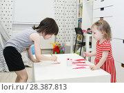 Купить «Little brother 5 years and sister 2 years painting at home», фото № 28387813, снято 25 марта 2018 г. (c) ivolodina / Фотобанк Лори