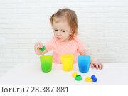 Купить «Cute lovely little 2 years girl sorts details by color», фото № 28387881, снято 12 февраля 2018 г. (c) ivolodina / Фотобанк Лори
