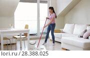 Купить «woman or housewife with mop cleaning floor at home», видеоролик № 28388025, снято 30 апреля 2018 г. (c) Syda Productions / Фотобанк Лори