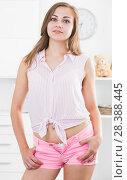 Купить «Girl in pink tight shorts at room», фото № 28388445, снято 24 июня 2017 г. (c) Яков Филимонов / Фотобанк Лори