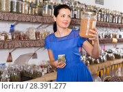 Купить «Woman choosing eco dried herbs sold by weight», фото № 28391277, снято 13 июня 2017 г. (c) Яков Филимонов / Фотобанк Лори