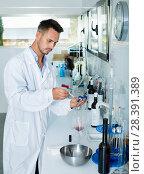 Купить «Man in chemical laboratory on winery», фото № 28391389, снято 12 декабря 2019 г. (c) Яков Филимонов / Фотобанк Лори