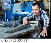 Купить «Male worker using his tools for repairing», фото № 28393881, снято 2 февраля 2017 г. (c) Яков Филимонов / Фотобанк Лори