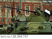 Perm, Russia - May 09, 2018: BTR-82A armored personnel carrier with a crew on a city street after the Victory Day parade. Редакционное фото, фотограф Евгений Харитонов / Фотобанк Лори