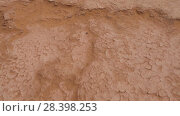 Купить «High angle POV walk on dry land in Sahara desert», видеоролик № 28398253, снято 10 мая 2018 г. (c) Кирилл Трифонов / Фотобанк Лори