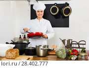 Female cook wearing uniform working on kitchen. Стоковое фото, фотограф Яков Филимонов / Фотобанк Лори