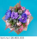 Купить «Artificial flowers handmade as decoration of a greeting card on a turquoise color background», фото № 28403333, снято 5 февраля 2018 г. (c) Олег Белов / Фотобанк Лори