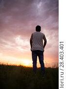Купить «Silhouette of a man against a beautiful sunset sky», фото № 28403401, снято 6 мая 2018 г. (c) Типляшина Евгения / Фотобанк Лори